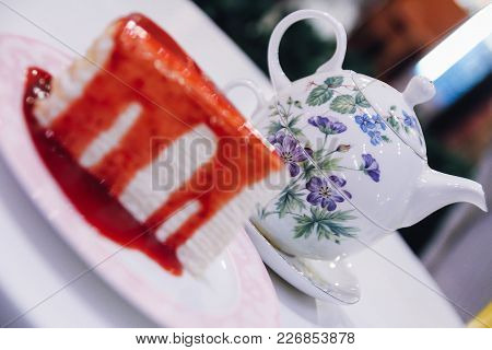 Strawberry Crepe Cake With Tea Pot Background. Strawberry Crepes Cake With Strawberry Sauce, Dessert