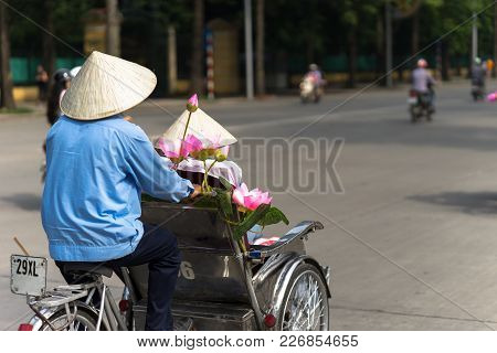 Cyclo (pedicab) Driver Wears Conical Hat On Hanoi Street