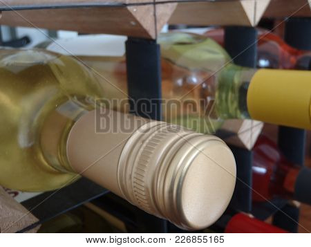 Close Up Of A Number Of Wine Bottles In A Rack