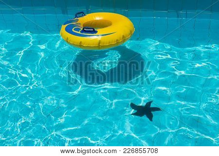 Swimming Pool Water With Yellow Floating Ring