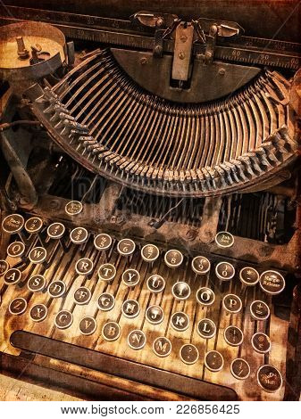 Close-up Of A Rusty Vintage Typewriter. Retro Style Photo.