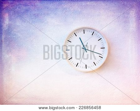 Modern Round Clock On Painted Purple Wall. Artistic Contemporary Home Decor.