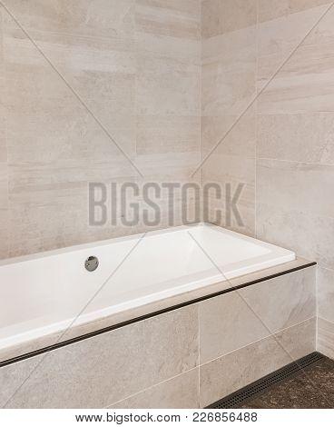 New Bathroom With Ceramic Tile Walls In Beige Tones. Contemporary Design.