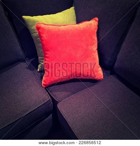 Bright Velvet Cushions On A Dark Textile Sofa. Modern Design.