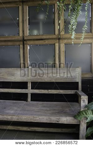 Wooden Bench In Home Garden, Stock Photo