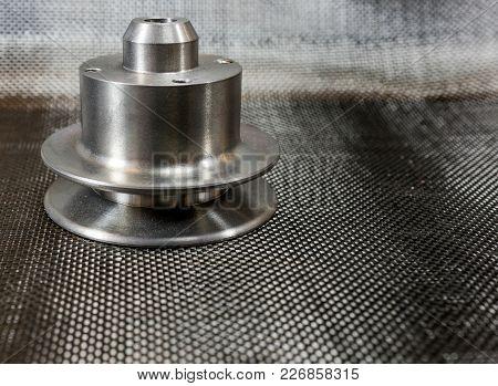 Shiny Steel Milled Billet Model A Water Pump Pulley On Plain Weave Carbon Fiber