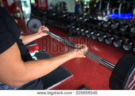 Closeup Of Sporty Male Hand Holding Weight
