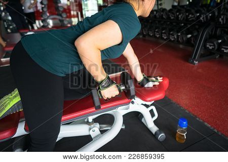 Asian Woman Lifting Dumbbells In Weight Training Fitness - Sport And Lifestyle Concept