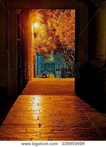 Old Medieval Street By Night In Town Korcula Croatia.