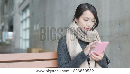 Woman use of mobile phone in campus