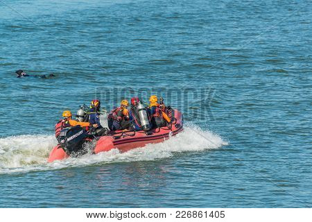 Nakhon Ratchasima, Thailand - December 23, 2017: Rescue Team Running Boat To Help Paasenger Falled I