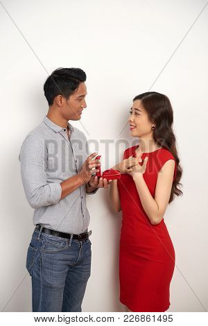 Handsome Asian Man Proposing To His Girlfriend And Giving Her Box With Engagement Ring