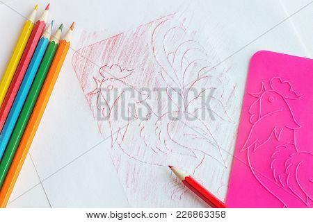 Colored Pencils And A  Relief Stencill, The Children's Creativity.
