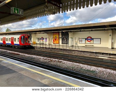 LONDON - FEBRUARY 12, 2018: A District Tine train arrives into Stamford Brook Underground Station in Chiswick, West London, UK.