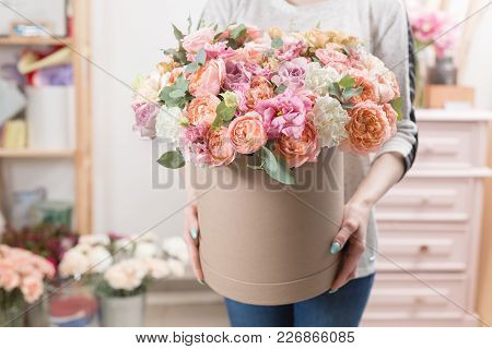 Beautiful Luxury Bouquet Of Mixed Flowers In Woman Hand. The Work Of The Florist At A Flower Shop. C