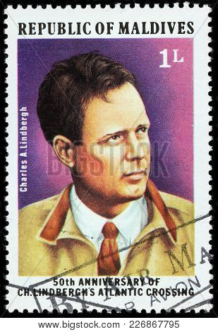 Luga, Russia - February 08, 2018: A Stamp Printed By Maldives Shows An American Aviator, Military Of