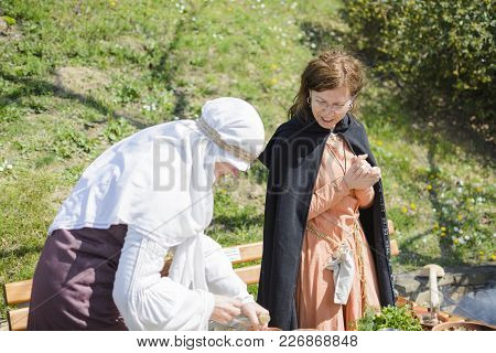 Veliko Tarnovo,bulgaria, April 04 2015, Two Woman With Vintage Clothes Cook Medieval Meal In The Med