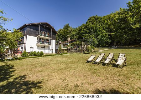 Sherba, Bulgaria, August 10, 2015: Little Girl Into A Terrace Leading To The Lounge Chair In The She