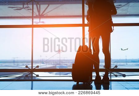 Silhouette Woman Travel With Luggage Looking Without Window At Airport Terminal International Or Gir