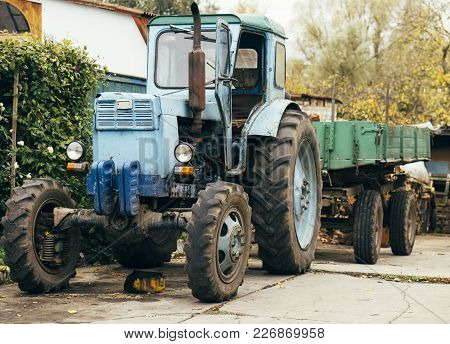 Old Rusty Tractor. Agricultural Machine Dilapidated Front Of The Farm. Old Iron. Tractor Waiting To