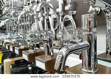 Closeup Faucets On Shelf.modern Kitchenware Water Faucets In The Store