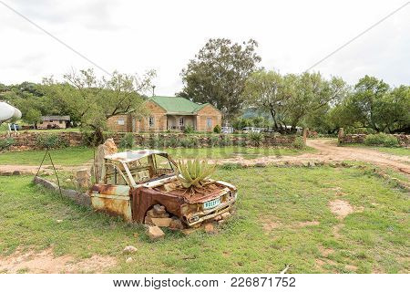 Excelsior, South Africa, February 10, 2018: A Guest House And Old Truck With Aloe Growing In Bonnet