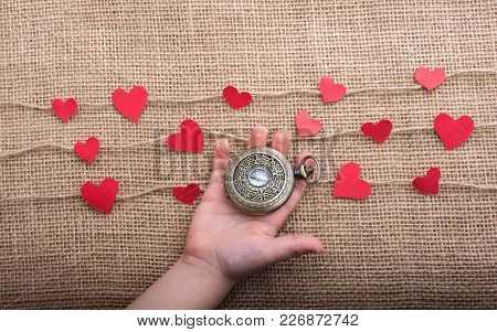 Love Concept With Pocket Watch And  Paper Hearts On Threads