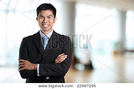 Asian Business Man With Arms Crossed.