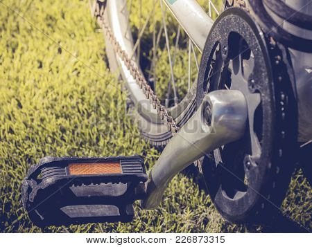 Bicycle Pedal With A Backdrop Of Artificial Grass