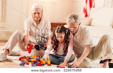 Calmness And Tranquility. Joyful Retired People Spending Their Weekend With A Charming Granddaughter