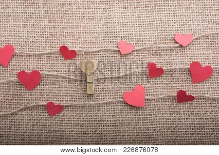 Love Concept With Heart Shaped Papers On Linen Threads