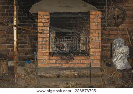 A Brick Blacksmith's Furnace For Heating Metal Workpieces