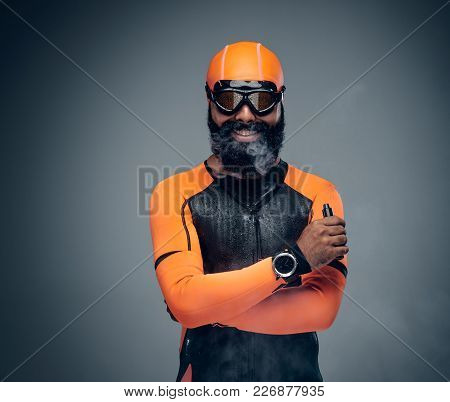 Funny Bearded Male In Scuba Diving Mask Smoking A Cigarette. Isolated On Grey Background.
