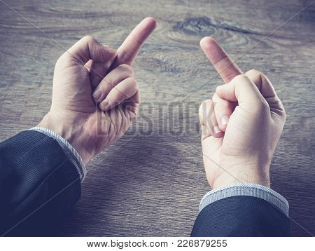 Young Businessman Showing Middle Finger Gesturing Fuck You , Concept About Angry Or Furious Business