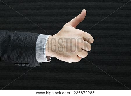 Businessman Showing Ok Sign With His Thumb Up Isolated With Black Background. Success Business Deal.