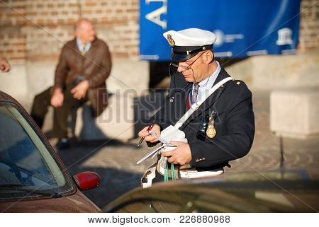 Torino, Italy, Oct.21, 2007: Intelligent Person Italian Police Man Gives A Ticket For Packing Rules