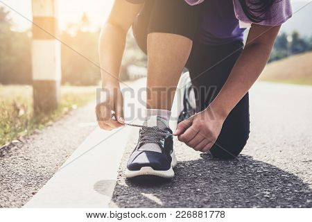 Healthy Lifestyle, Runner Tying Running Shoes Getting Ready For Race On Run Track Jog Workout Wellne