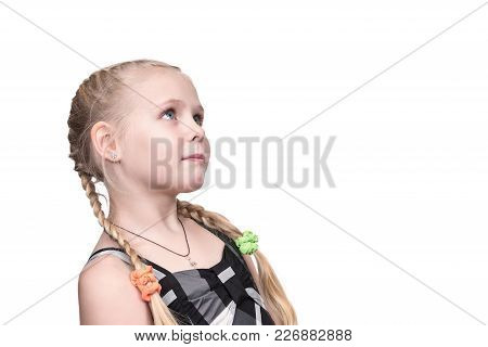 Portrait Of Little Beautiful Girl Looking Sideways And Upwards Isolated On White Background