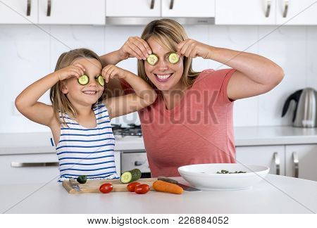 Attractive Woman Cooking Together With Her Sweet Beautiful Blond Little 6 Or 7 Years Old Daughter Ha