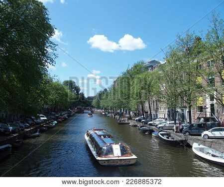 Amsterdam, Netherlands Europe On July 2015: Touristic Boat In Canal Gracht Ready To Cruise And Tradi