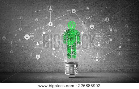 Lightbulb With Human From Gears Inside Placed Against Social Network System On Grey Wall. 3d Renderi