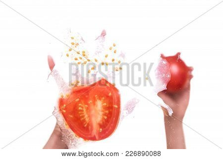 Female Hands Throwing Tomatoes