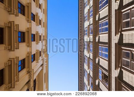Classical Building Facades Under Blue Sky, Narrow Street Of Vienna, Austria. Architectural Backgroun