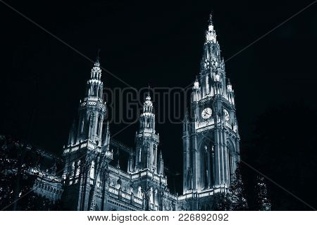 Rathaus Of Vienna. Town Hall Facade At Night, Blue Toned Monochrome Photo