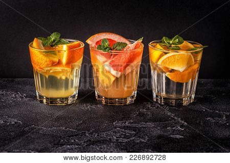 Lemon, Grapefruit, Orange Homemade Cocktail/detox Fruit Infused Water, Selective Focus.
