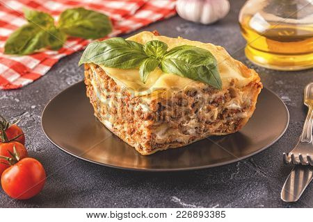 Traditional Lasagna Made With Minced Beef Bolognese Sauce And Bechamel Sauce Topped With Basil Leave