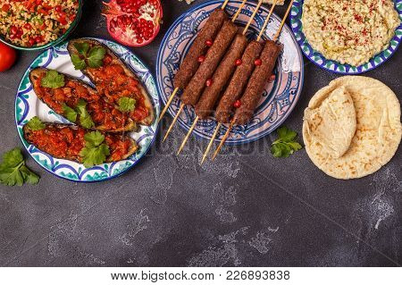 Classic Kebabs, Tabbouleh Salad, Baba Ganush And Baked Eggplant With Sauce. Traditional Middle Easte