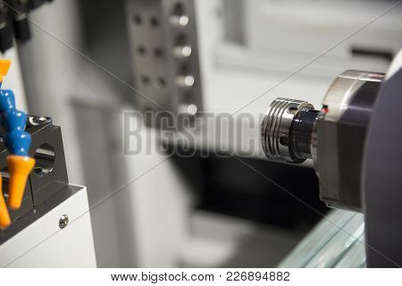 The Cnc Lathe Machine Cutting The Thread At The End Of The Shaft.