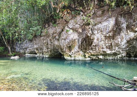 The Bladen River Flows Under Limestone Cliffs In One Of The Most Biodiverse And Untouched Pieces Of