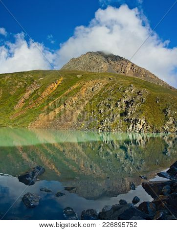 Beautifull Turquoise Lake Mirror  With View To Hill  In Altaj, Russia  At The Summer